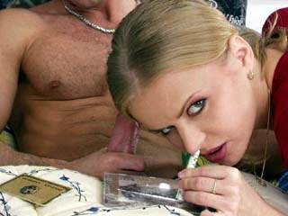 Okay, so our blonde bimbo Dora only does a little coke in this set, but you won't care!  She offers her dealer a blowjob in exchange for some lines.  He suggests a little ass fucking as well.  She agrees. You watch!